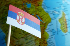 Serbia flag with a globe map as a background Royalty Free Stock Image