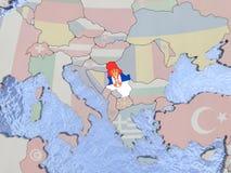 Serbia with flag on globe Stock Photo