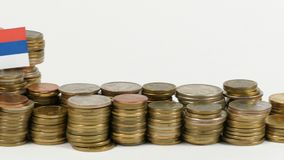 Serbia flag with stack of money coins. Serbia flag waving with stack of money coins stock footage