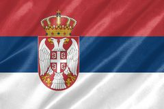 Serbia Flag. With waving on satin texture royalty free stock image