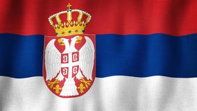 Serbia flag waving in the wind. Closeup of realistic Serbian flag with highly detailed fabric texture