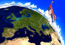 Serbia national flag marking the country location on world map. 3D rendering, parts of this image furnished by NASA Royalty Free Stock Photos