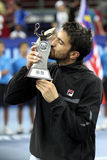 Serbia's Janko Tipsarevic kiss his trophy. After winning his men's singles final againts Cypru's Marcos Baghdatis at the ATP Malaysia Open tennis tournament in Royalty Free Stock Images