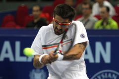 Serbia's Janko Tipsarevic return the ball. From Marcos Baghdatis during his men's singles final againts Cypru's Marcos Baghdatis at the ATP Malaysia Open tennis Stock Images