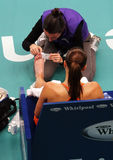 Serbia's Jelena Jankovic receives medical help. PARIS - FEBRUARY 13: Serbia's Jelena Jankovic receives medical treatment during quater finals at Open GDF SUEZ Royalty Free Stock Photos