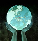 Serbia on blue globe in hands. Serbia on shiny blue globe in hands in space. 3D illustration stock image