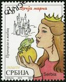 SERBIA - 2015: shows The Princess and the Frog, series Characters from children`s books. SERBIA - CIRCA 2015: A stamp printed in Republic of Serbia shows The stock photo