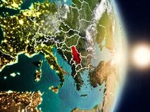 Serbia during sunrise. Highlighted in red on planet Earth with visible country borders. 3D illustration. Elements of this image furnished by NASA Royalty Free Stock Image