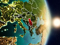 Serbia during sunrise. Highlighted in red on planet Earth with visible country borders. 3D illustration. Elements of this image furnished by NASA Stock Image