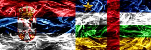 Serbia vs Central African Republic smoke flags placed side by si. De. Thick colored silky smoke flags of Serbian and Central African Republic stock photography