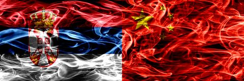 Serbia vs China, Chinese smoke flags placed side by side. Thick stock images