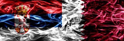 Serbia vs Qatar, Qatari smoke flags placed side by side. Thick c. Olored silky smoke flags of Serbian and Qatar, Qatari stock images