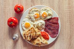 Serbian breakfast with eggs, ham, cheese, ajvar and homemade bread. Traditional Serbian breakfast with eggs, ham, cheese, ajvar and homemade bread royalty free stock photos