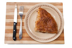 Serbian burek pie served on the wooden board Royalty Free Stock Photo