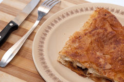 Serbian burek pie served on the wooden board Royalty Free Stock Photos