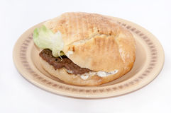 Serbian burger with lettuce served on a plate Royalty Free Stock Images