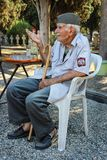 Serbian cemetery keeper Djordje Mihailovic. Portrait of famous Serbian cemetery keeper Djordje Mihailovic, telling a story to visitors in Thessaloniki, Greece stock image