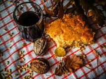 Bread, wine and nuts on a rustic surface. Serbian Christmas costume. Serbian Christmas costume. Serbian Christmas food. royalty free stock images