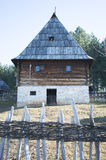 Serbian country house. Serbian traditional rural house behind wooden fence royalty free stock photos