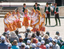 Serbian dancers at the Rose Festival in the central square of the town of Karlovo in Bulgaria Stock Photo