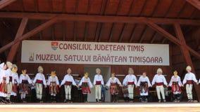 Serbian dancers. TIMISOARA, ROMANIA - JULY 7, 2019: Serbian dancers in traditional costume, perform folk dance during International Festival of hearts organized stock video