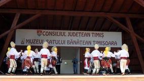 Serbian dancers. TIMISOARA, ROMANIA - JULY 7, 2019: Serbian dancers in traditional costume, perform folk dance during International Festival of hearts organized stock footage