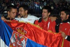 SERBIAN DAVIS CUP TIM CELEBRATE. BELGRADE - MARCH 7:Serbian Davis Cup tim from left:Troicki,Zimonjic,Djokovic,Tipsarevic celebrate a victory against USA in DAVIS Stock Photography