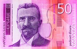 Serbian 50 dinar currency banknote, close up. Serbia money RSD c. Ash, macro view, portrait of Stevan Mokranjac royalty free stock photography