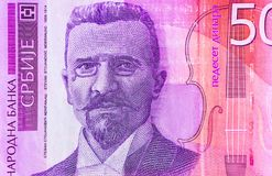 Serbian 50 dinar currency banknote, close up. Serbia money RSD c. Ash, macro view, portrait of Stevan Mokranjac stock photos