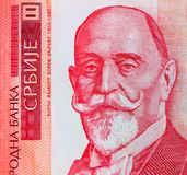 Serbian 1000 dinara currency banknote, close up. Serbia money RS. D dinar cash, macro view, portrait of Dorde Vajfert stock images