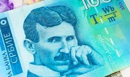 Serbian 100 dinara currency banknote, close up. Serbia money RSD dinar cash, macro view, portrait of scientist Nikola Tesla. royalty free stock photo