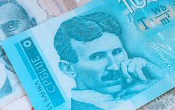 Serbian 100 dinara currency banknote, close up. Serbia money RSD dinar cash, macro view, portrait of scientist Nikola Tesla. royalty free stock photos