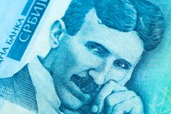 Serbian 100 dinara currency banknote, close up. Serbia money RSD dinar cash, macro view, portrait of scientist Nikola Tesla. stock photos