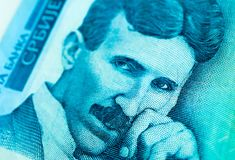 Serbian 100 dinara currency banknote, close up. Serbia money RSD dinar cash, macro view, portrait of scientist Nikola Tesla. stock photography
