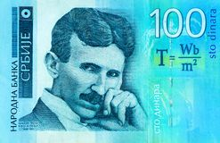 Serbian 100 dinara currency banknote, close up. Serbia money RSD dinar cash, macro view, portrait of scientist Nikola Tesla. royalty free stock photography
