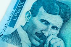 Serbian 100 dinara currency banknote, close up. Serbia money RSD dinar cash, macro view, portrait of scientist Nikola Tesla. royalty free stock images
