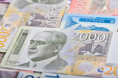 Serbian dinars banknotes. Banknote of 2000 Serbian dinars RSD and pile of different bills royalty free stock photos