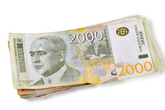 Serbian dinars banknotes. Stack of Serbian banknotes on white royalty free stock photo
