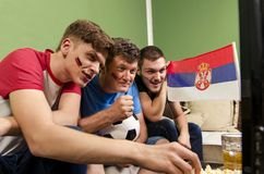 Serbian fans watching soccer game on tv stock photo