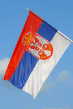 Serbian flag. Flag of republic of Serbia on sunny day withouth wind Royalty Free Stock Images