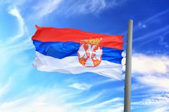 Serbian flag. Flag of Serbia against the background of the sky royalty free stock images