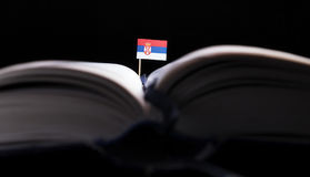 Serbian flag in the middle of the book. Knowledge and education. Concept stock images