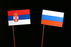Serbian flag with Russian flag on black. Background stock photo