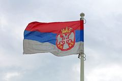 Serbian Flag. Flying at Wind stock image