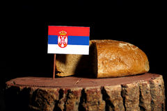 Serbian flag on a stump with bread stock photography
