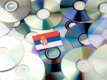 Serbian flag on top of CD and DVD pile isolated on white. Serbian flag on top of CD and DVD pile isolated Stock Images