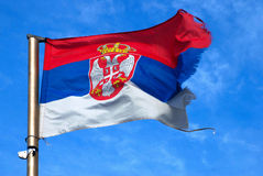 Serbian flag. Waving in the blue sky stock photo