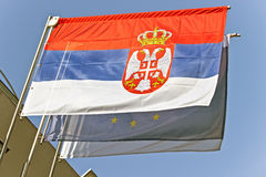 Serbian flag waving with European Union flag Royalty Free Stock Images