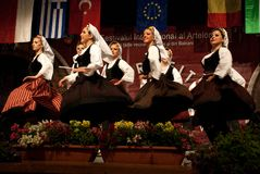 Serbian folk dancers at a festival. Serbian woman folk dancers from KUD Dimitrije KOTUROVIÄŠ ensemble - BELGRADE, SERBIA, dancing at the International Festival royalty free stock photos
