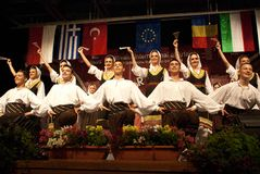 Serbian folk dancers at a festival. Serbian folk dancers from KUD Dimitrije KOTUROVIÄŠ ensemble - BELGRADE, SERBIA, dancing at the International Festival of stock photos